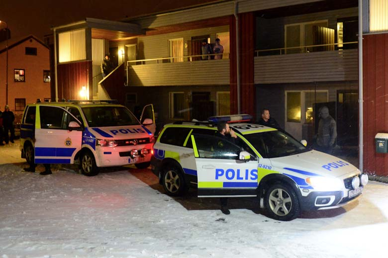 Swedish police stand by police cars outside a house used as a temporary shelter for asylum seekers in Boliden in northeastern Sweden on November 19, 2015, after police raided the house. A man believed to be suspected of planning terror attacts in Sweden has been arrested, Swedish Security Service (SAPO) confirms. Swedish media had published the photo of the alleged suspect, Mutar Muthanna Majid, reporting that he has fought alongside 'ISIS' in Syria.  (Getty)