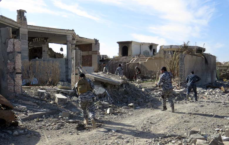 Iraq government troops remove bombs planted in houses and streets in Ramadi's Husseiba easten district on February 15, 2016, after retaking the city from the Islamic State group. The government retook Ramadi over the past weeks and efforts to reconquer more land from IS are now expected to focus on Mosul, the jihadists' main hub in Iraq. (Getty)