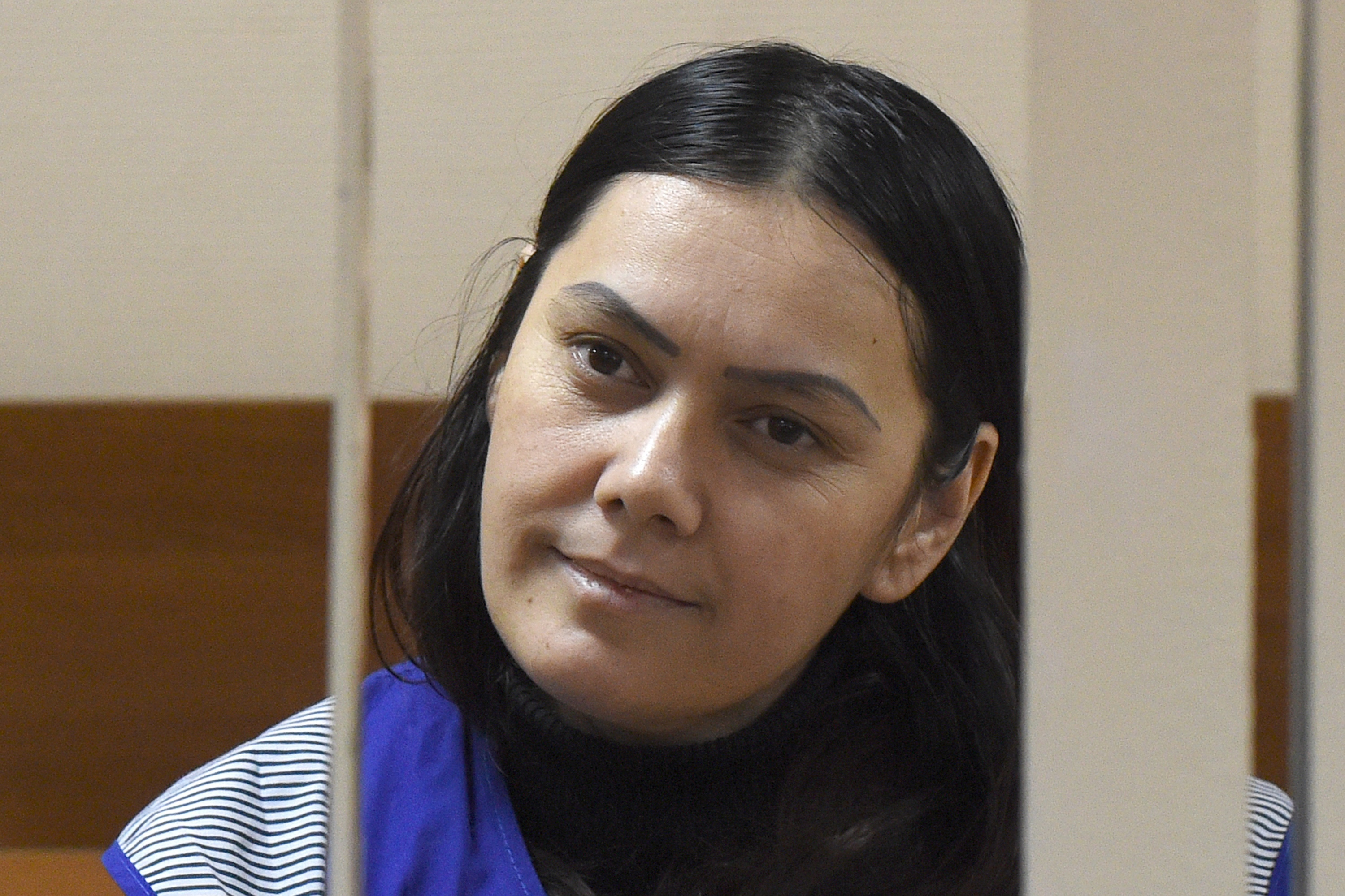 Gyulchekhra Bobokulova, a nanny suspected of killing a young girl in her care, looks out from a defendants' cage during a hearing at a court in Moscow, on March 2, 2016.  (Vasily Maximov/AFP/Getty)