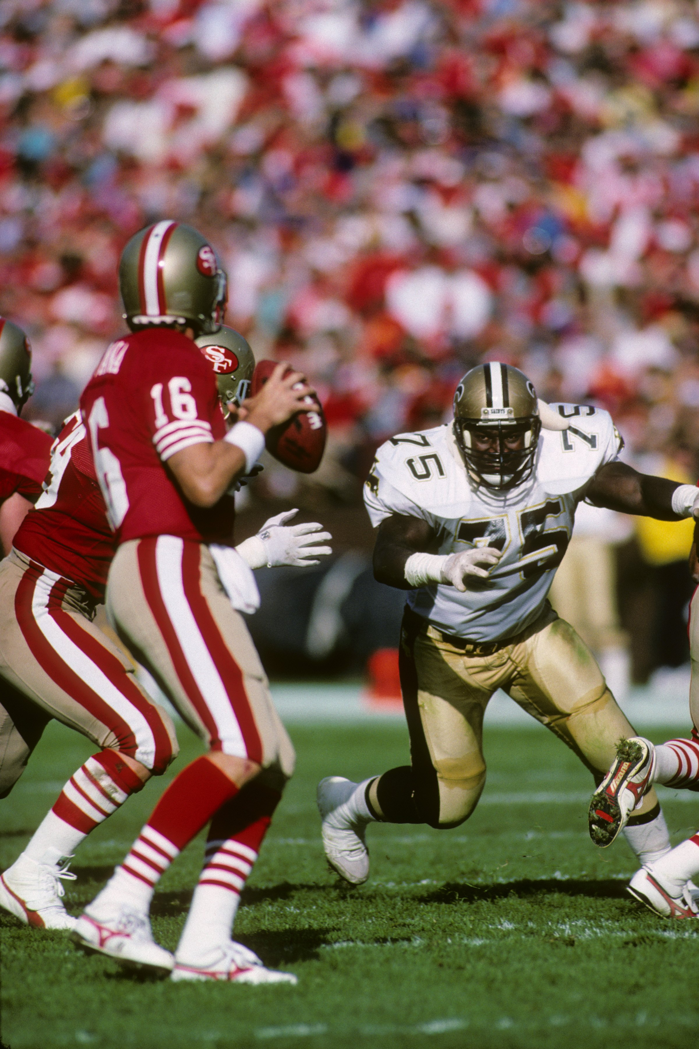 Montana playing against the Saints in 1987. (Getty)