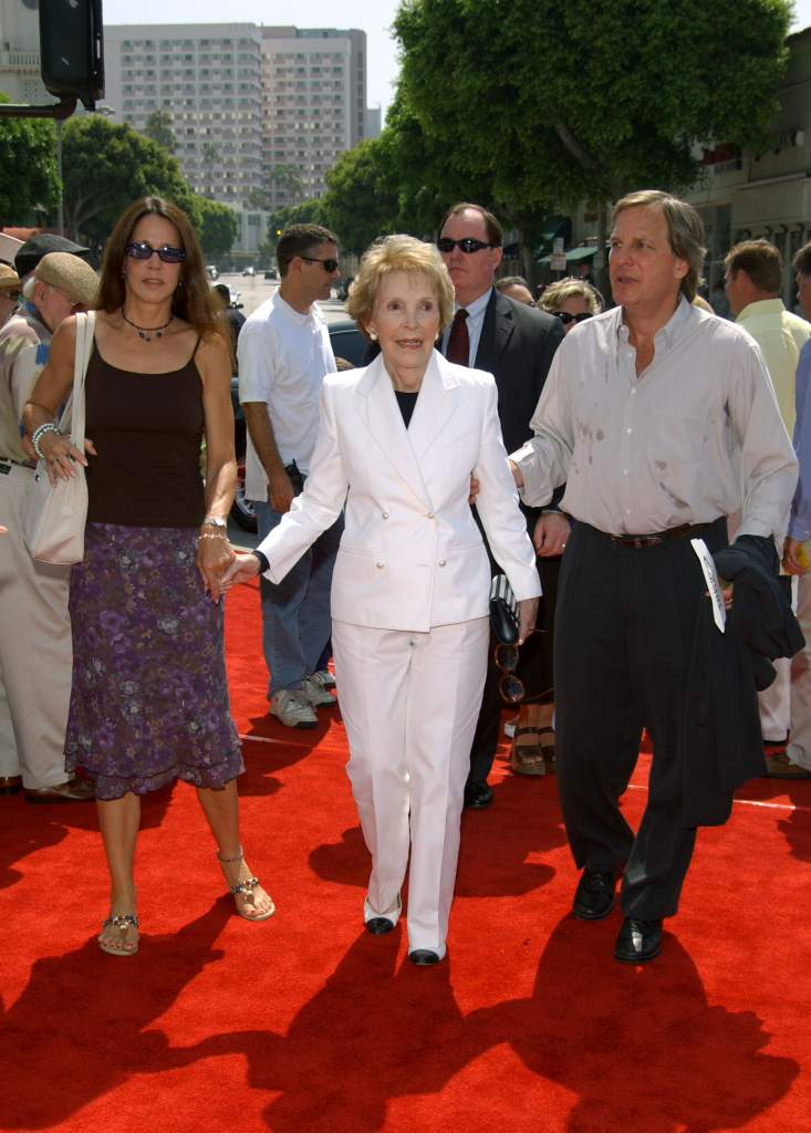 """LOS ANGELES - JULY 14: Former First Lady Nancy Reagan (C) arrives with daughter, Patti Davis and Doug Wick (R) at the premiere of the movie """"Stuart Little 2"""" at the Mann's Village Theater on July 14, 2002 in Los Angeles, California. (Photo by Sebastian Artz/Getty Images)"""