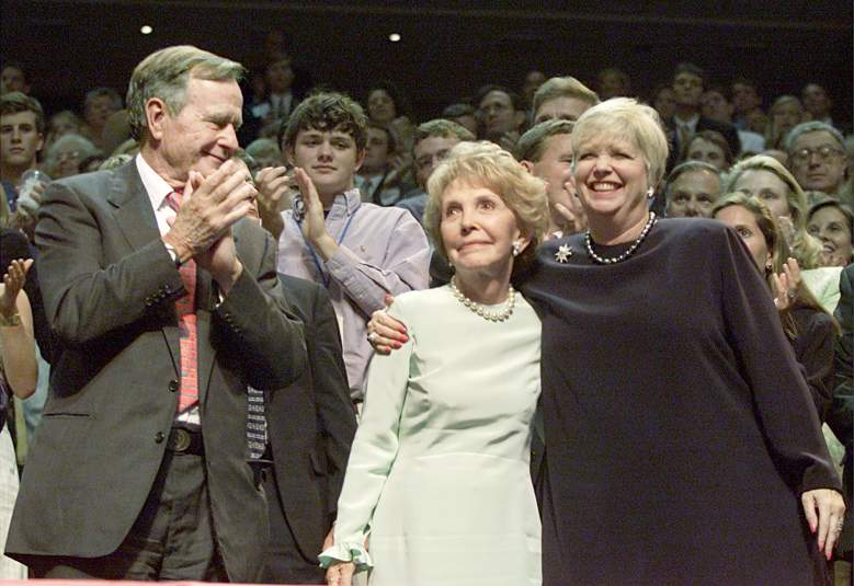 374855 13: (FILE PHOTO) Former First Lady Nancy Reagan, center, receives a hug from Maureen Reagan, the eldest daughter of former President Ronald Reagan, as former President George Bush shows support during the second day of the Republican National Convention August 1, 2000 in Philadelphia, PA. Maureen Reagan died at the age of 60 after a five-year-long battle with malignant melanoma August 8, 2001 at her home in Granite Bay, CA. (Photo by Mark Wilson/Getty Images)
