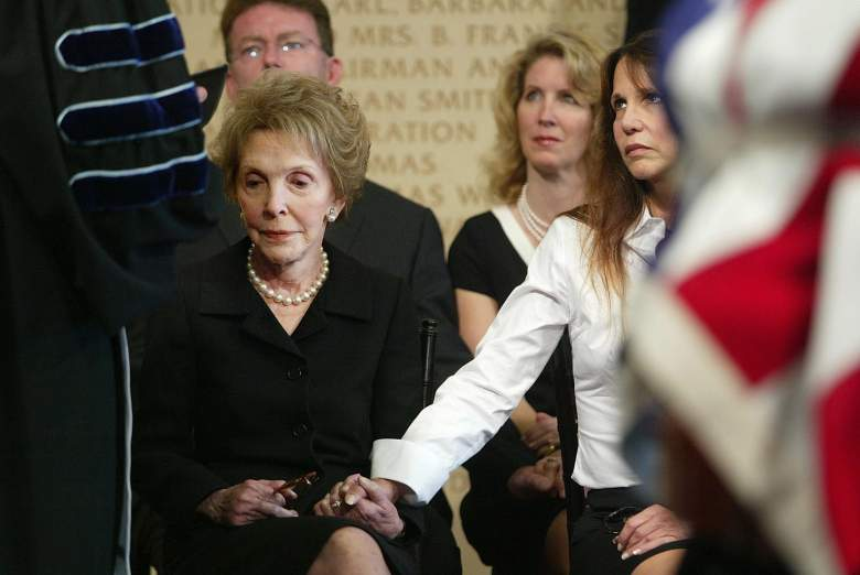 SIMI VALLEY, UNITED STATES: Former First Lady Nancy Reagan(L) sits with daughter Patti Davis behind the casket that contains the remains of former US President Ronald Reagan inside the Ronald Reagan Presidential Library during the memorial service 07 June, 2004 in Simi Valley, California. AFP PHOTO/POOL/Rick Bowmer (Photo credit should read RICK BOWMER/AFP/Getty Images)