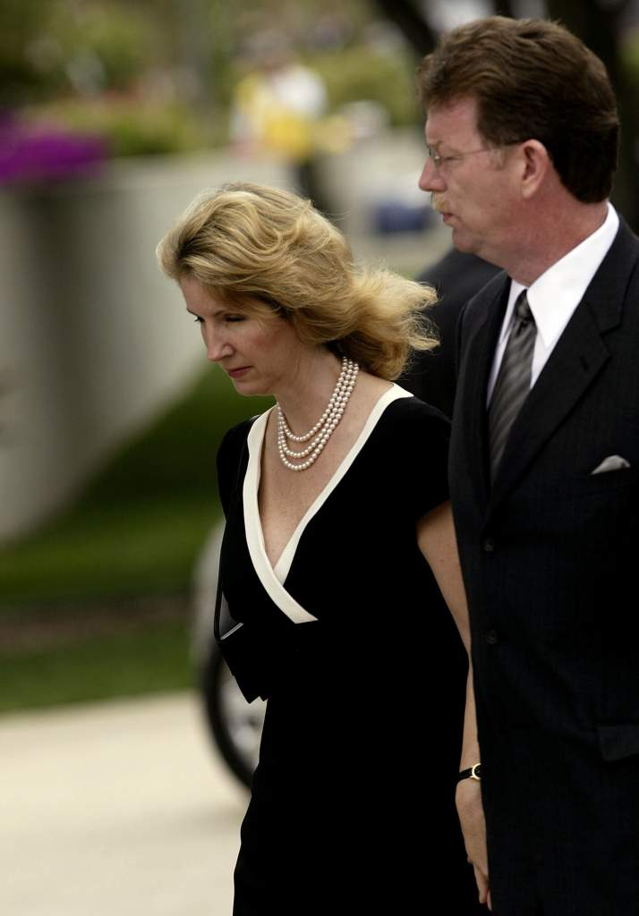 SIMI VALLEY, CA - JUNE 7: Dennis Revell, former husband of Maureen Reagan (R) and fiance Diana Wilson arrive at the Ronald Reagan Presidential Library for the memorial service June 7, 2004 in Simi Valley, California. Reagan died of natural causes at age 93 at his home in California. (Photo by David McNew/Getty Images)
