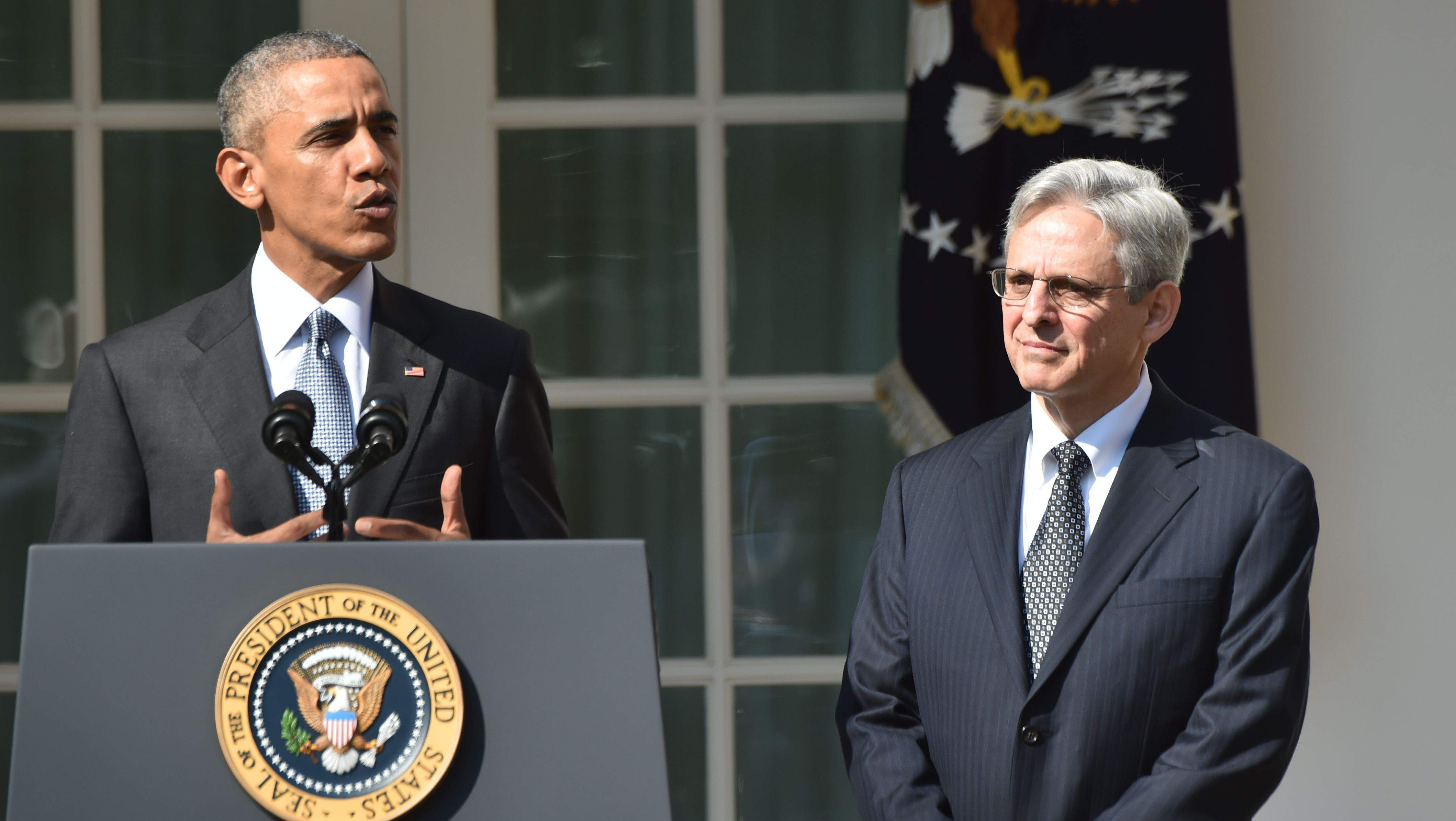 Merrick Garland watches as he is introduced by President Obama. (Getty)