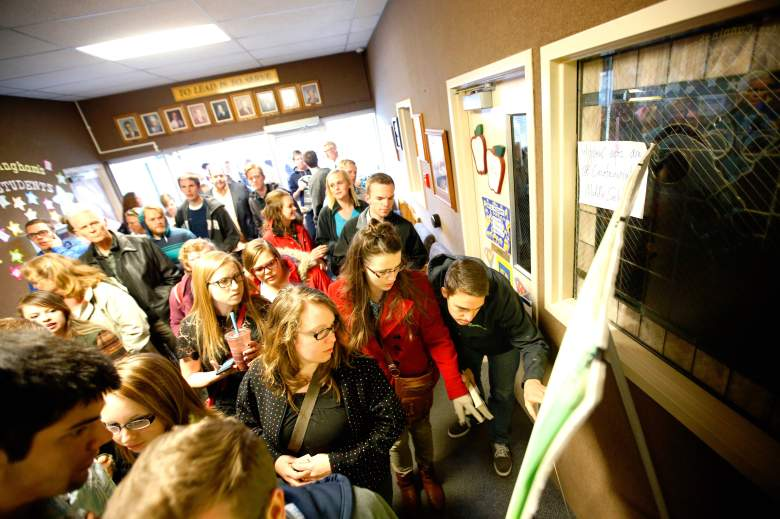 PROVO, UT - MARCH 22: Voters look for their district on a map for the Utah Republican caucuses at Wasatch Elementary on March 22, 2016 in Provo, Utah. The Republicans have 40 delegates and Democrats 37 delegates at stake in Utah. (Photo by George Frey/Getty Images)