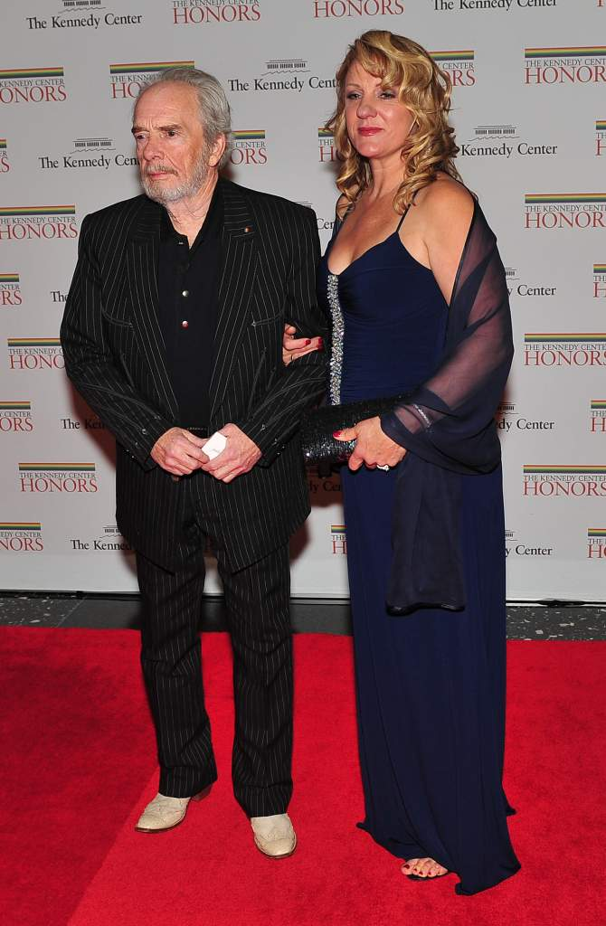 WASHINGTON, DC - DECEMBER 4: (AFP OUT) Merle Haggard, one of the 2010 Kennedy Center honorees, arrives with his wife, Theresa Ann Lane, for the formal artist's dinner for the Kennedy Center Honors at the United States Department of State December 4, 2010 in Washington, D.C. (Photo by Ron Sachs-Pool/Getty Images)