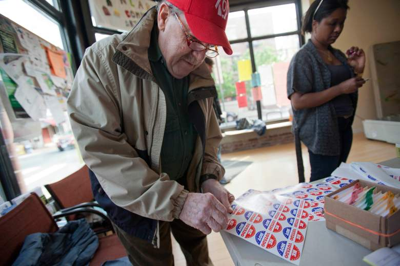 PHILADELPHIA, PA - APRIL 24: Jerry Perisho, 73, left, takes a sticker printed in Spanish after casting his ballot during the Republican primary election April 24, 2012 at Northern Liberties Neighbors Association in Philadelphia, Pennsylvania. Turnout is expected to be low as Former Massachusetts Gov. Mitt Romney continues his campaign as the presumptive GOP candidate. (Photo by Jessica Kourkounis/Getty Images)