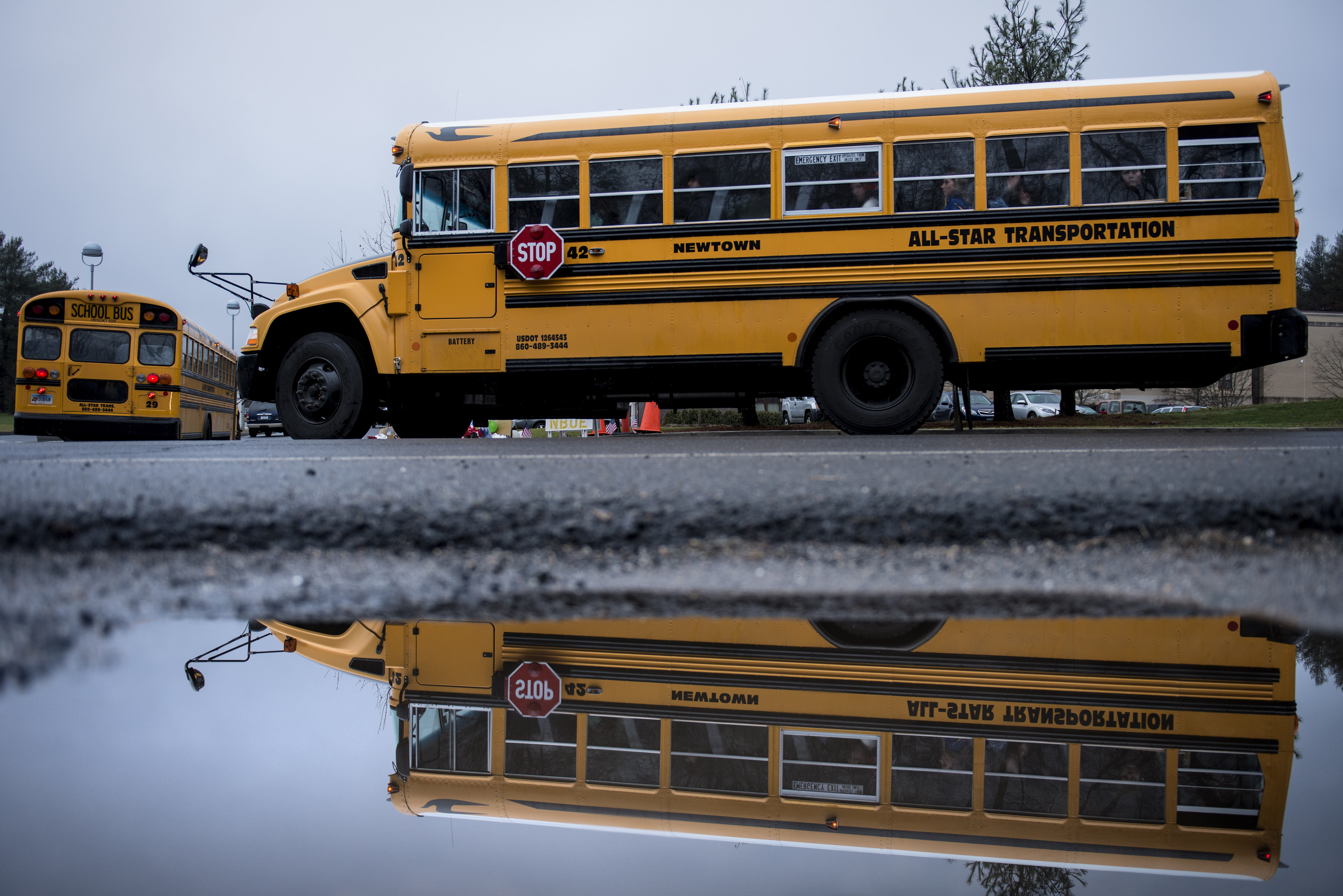 A school bus takes students to Newtown High School December 18, 2012 in Newtown, Connecticut. (Getty)