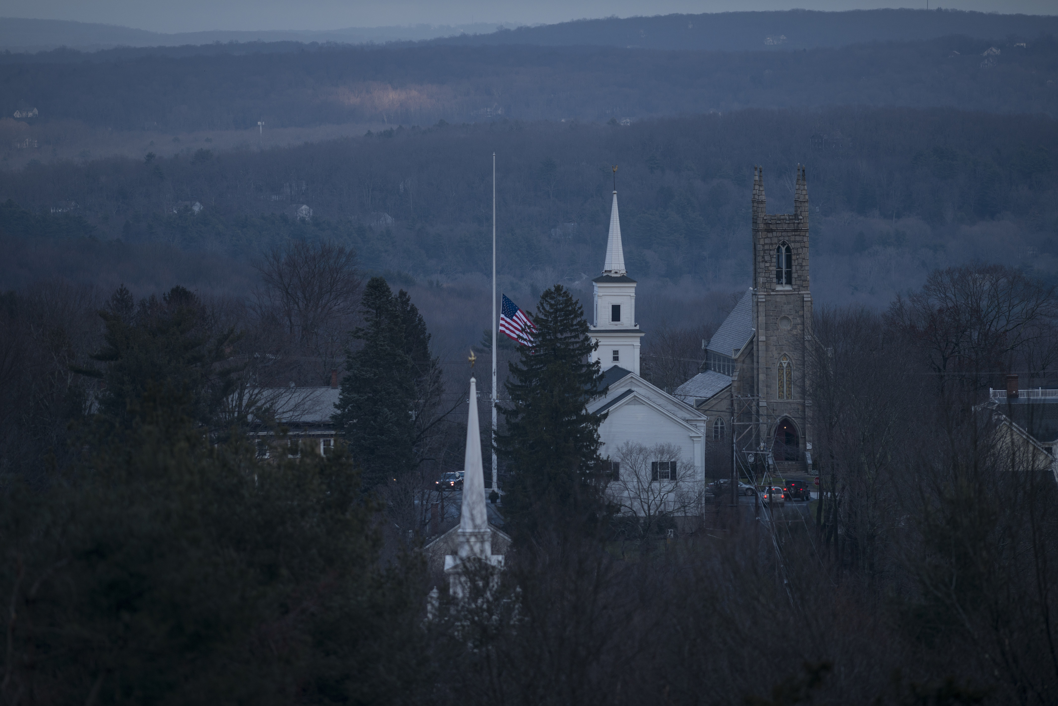 A view of the Newtown Meetinghouse and Trinity Episcopal Church as Main Street's flag flies at half-staff on December 18, 2012 in Newtown, Connecticut. (Getty)