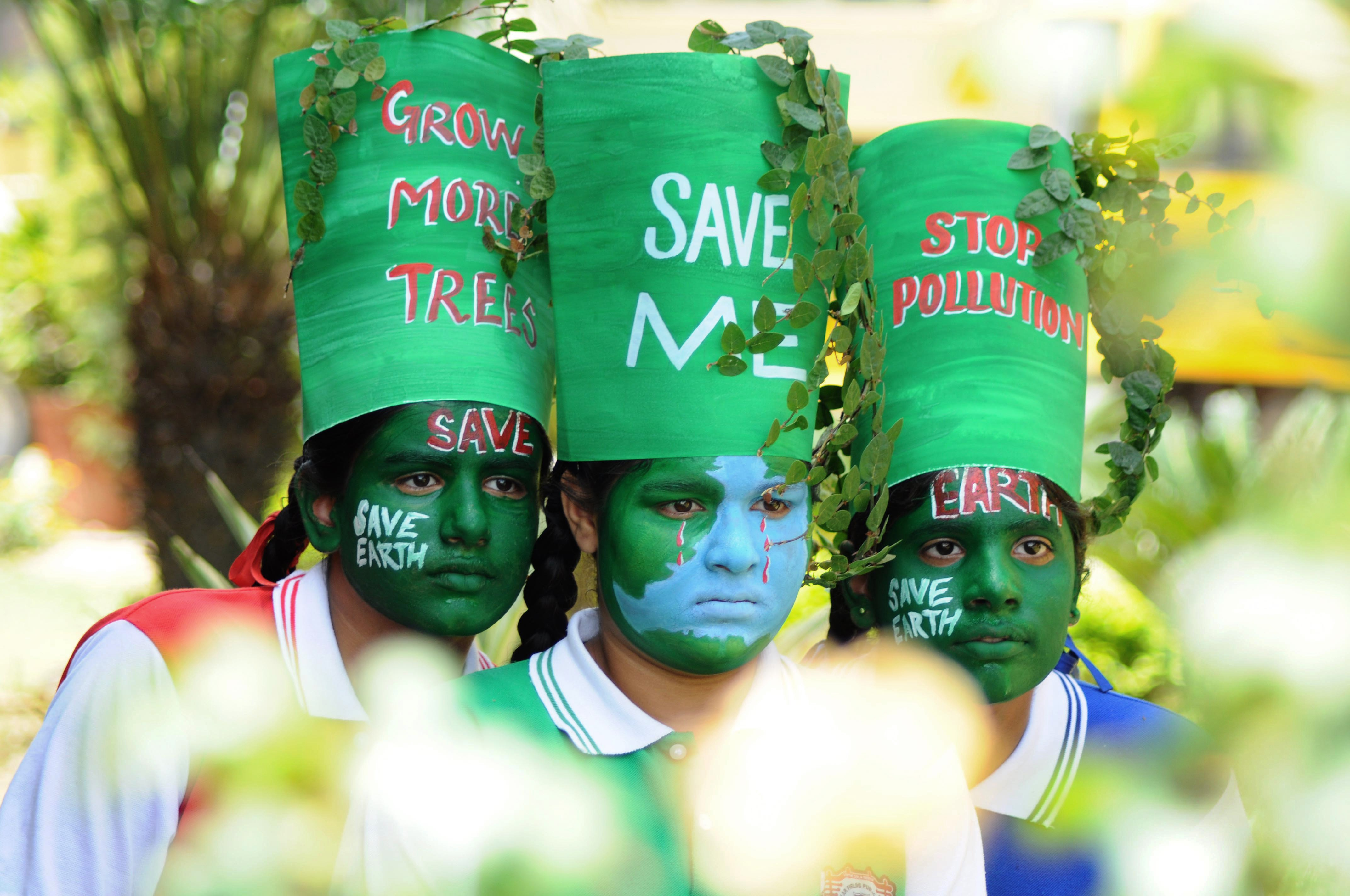 Young Indian girls pose with their painted faces during a 'Save Earth' awareness programme on the eve of World Earth Day at a school in Patiala on April 21, 2015.  (Getty)