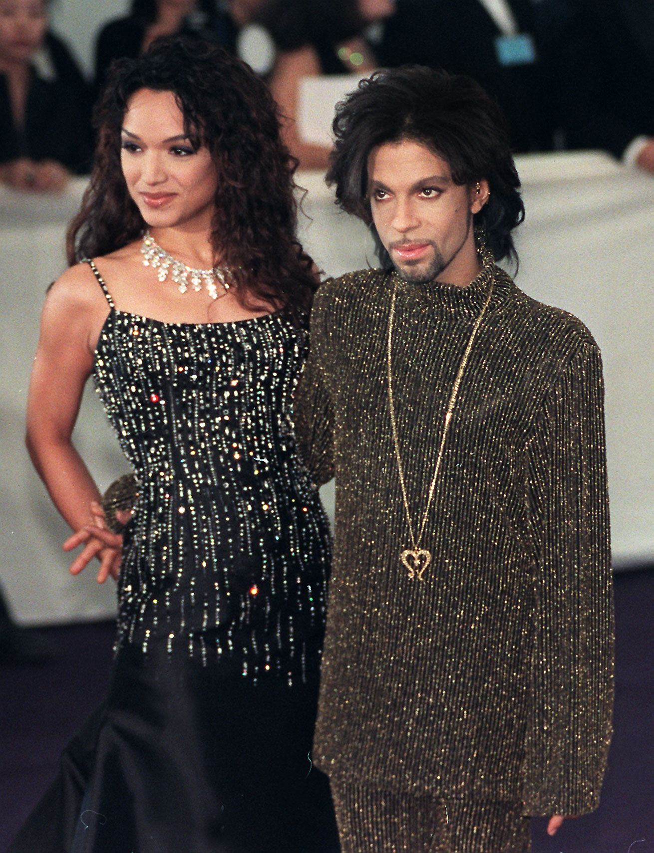 "Prince poses for photographers with his wife Mayte as they arrives at the De Beer and Versace ""Diamonds are forever"" charity fashion event 09 June 1999. (Getty)"