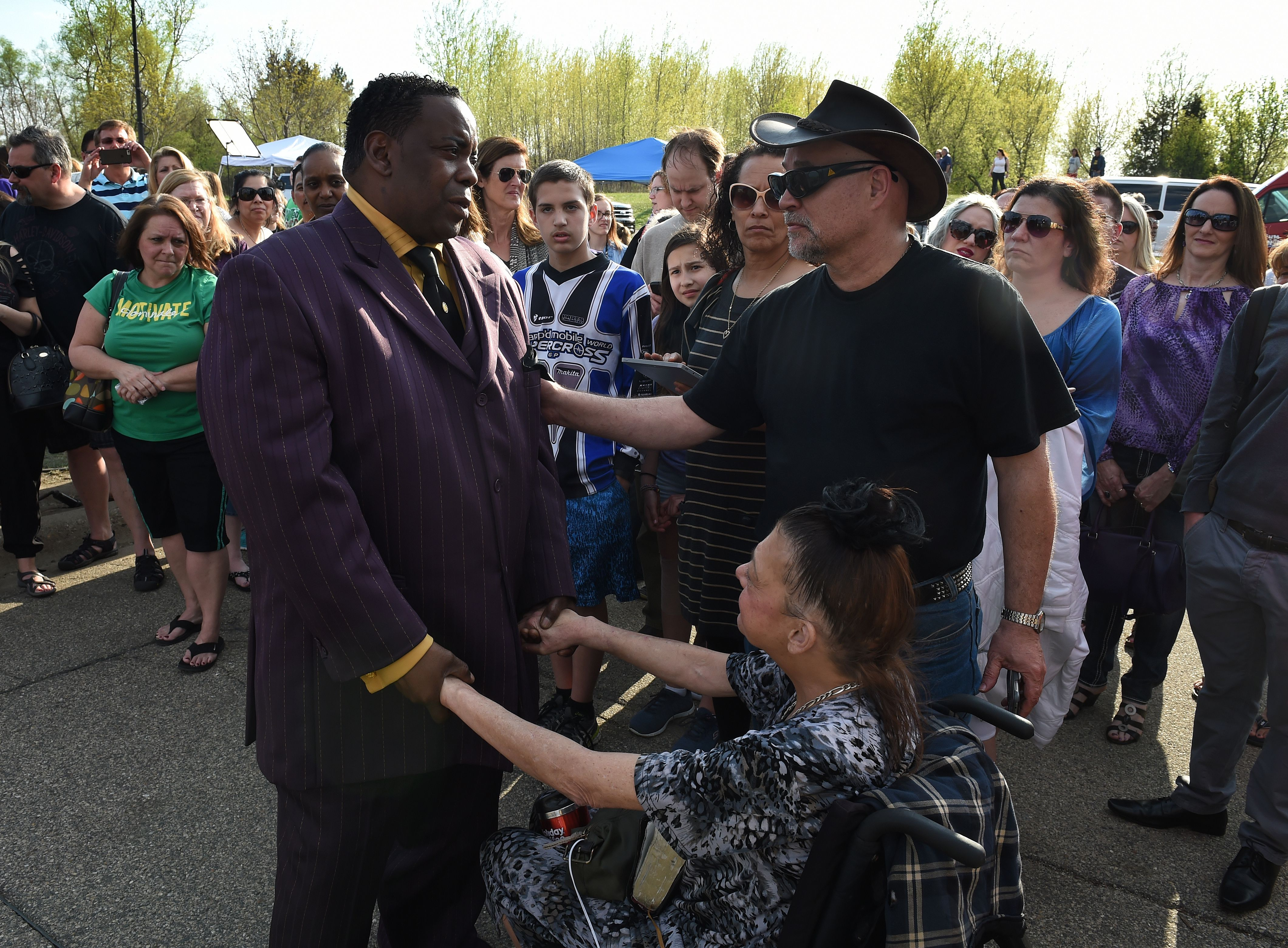 Maurice Phillips, left, the brother-in-law of Prince, talks with fans following a memorial service held inside the Paisley Park compound of music legend Prince. (Getty)