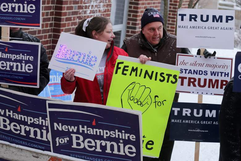 MANCHESTER, NH - FEBRUARY 09: Supporters of presidential candidates Sen. Bernie Sanders and Donald Trump visit while holding signs outside the polling place at the Webster School February 9, 2016 in Manchester, New Hampshire. Tuesday is the 100th anniversary of the New Hampshire primariy, the 'First in the Nation' test for presidential candidates from both parties. (Photo by Chip Somodevilla/Getty Images)