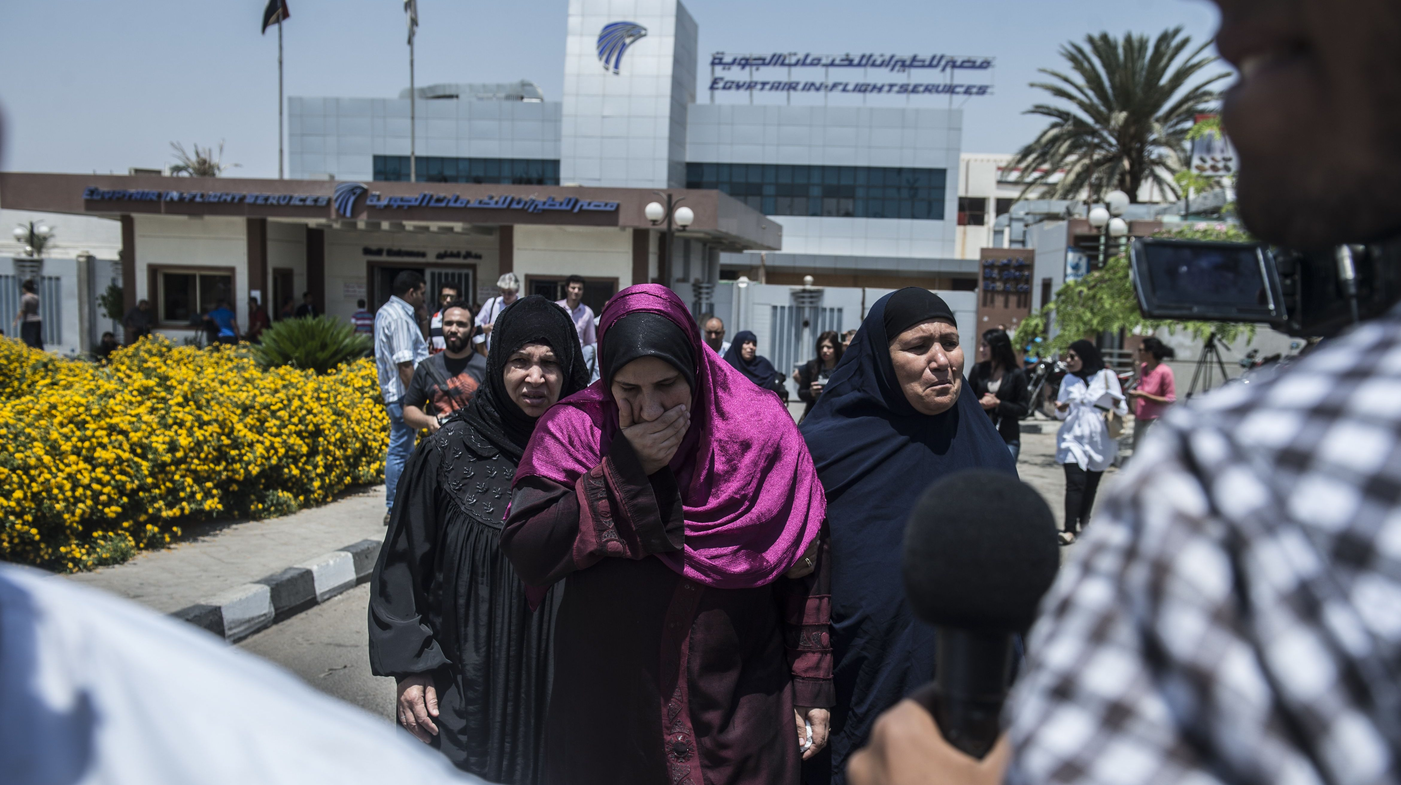 Family members of passengers who were flying aboard an EgyptAir plane that vanished from radar en route from Paris to Cairo overnight get ready to be transported by bus to a gathering point at Cairo airport on May 19, 2016. (Getty)
