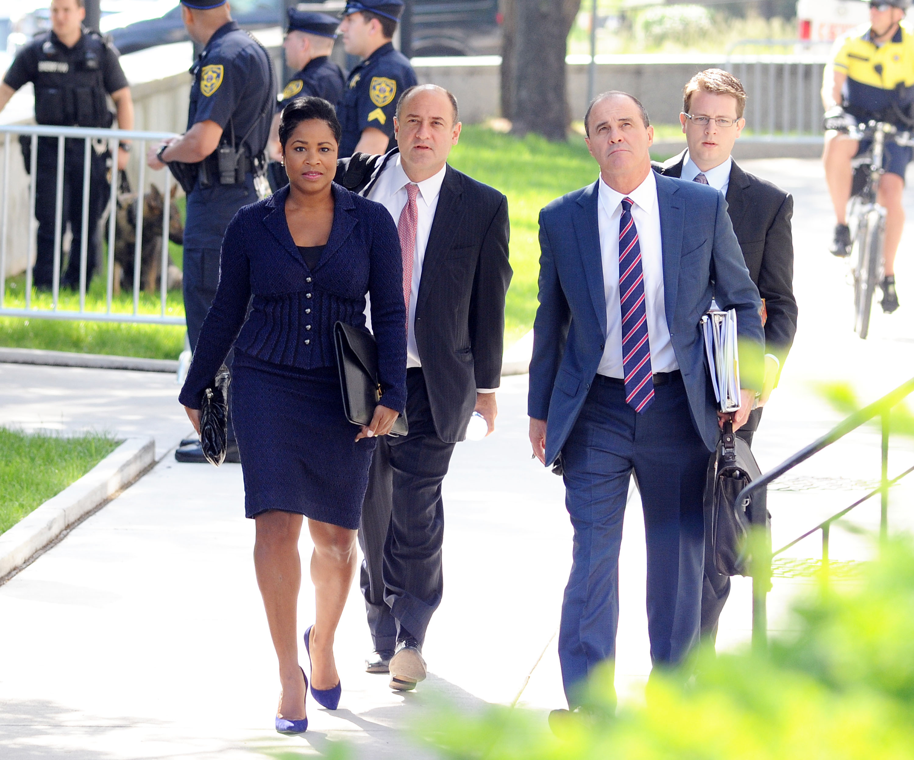 Bill Cosby's legal team, including Monique Pressley, left, and Brian McMonagle, right, arrive for a preliminary hearing on sexual assault charges at Montgomery County Courthouse on May 24, 2016 in Norristown, Pennsylvania. (William Thomas Cain/Getty)