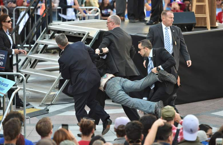 Secret Service agents arrest a man for climbing over a barricade and approaching Democratic presidential candidate Bernie Sanders while he speaks at Frank Ogawa Plaza in Oakland, California on May 30, 2016. / AFP / JOSH EDELSON (Photo credit should read JOSH EDELSON/AFP/Getty Images)
