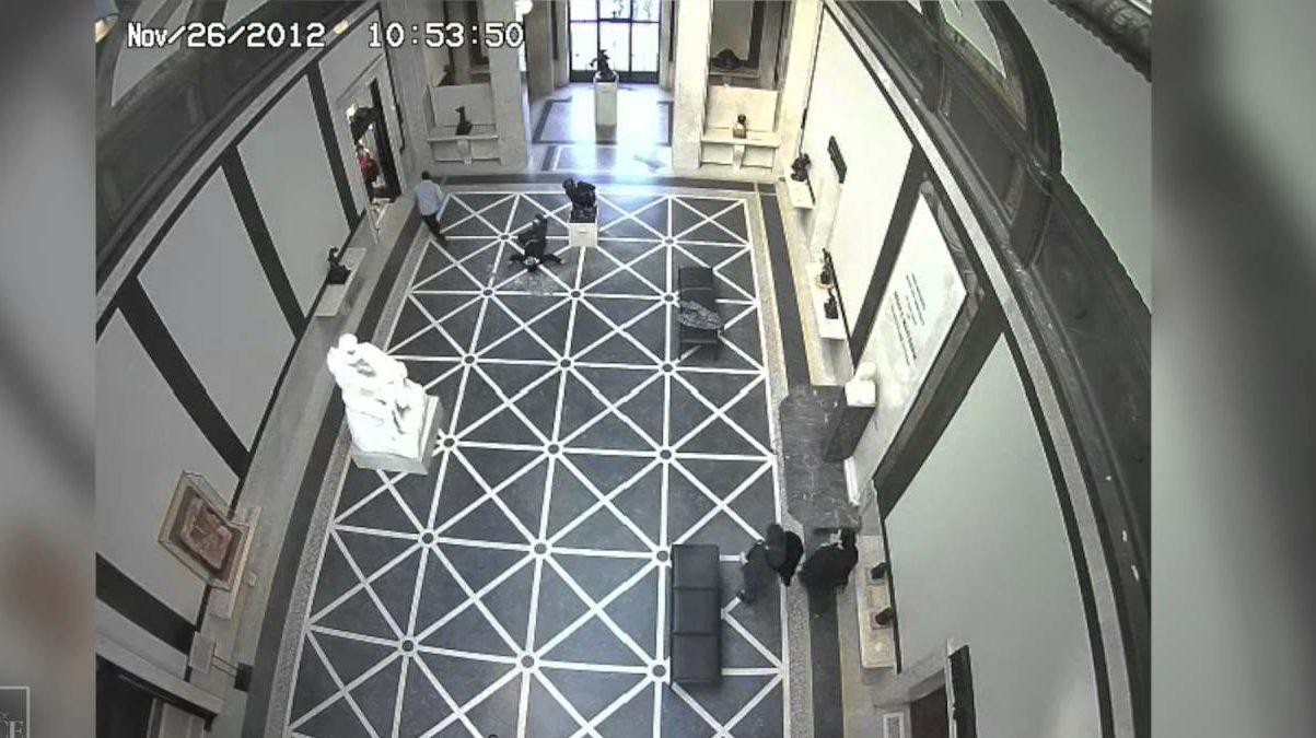 museum worker falls through glass