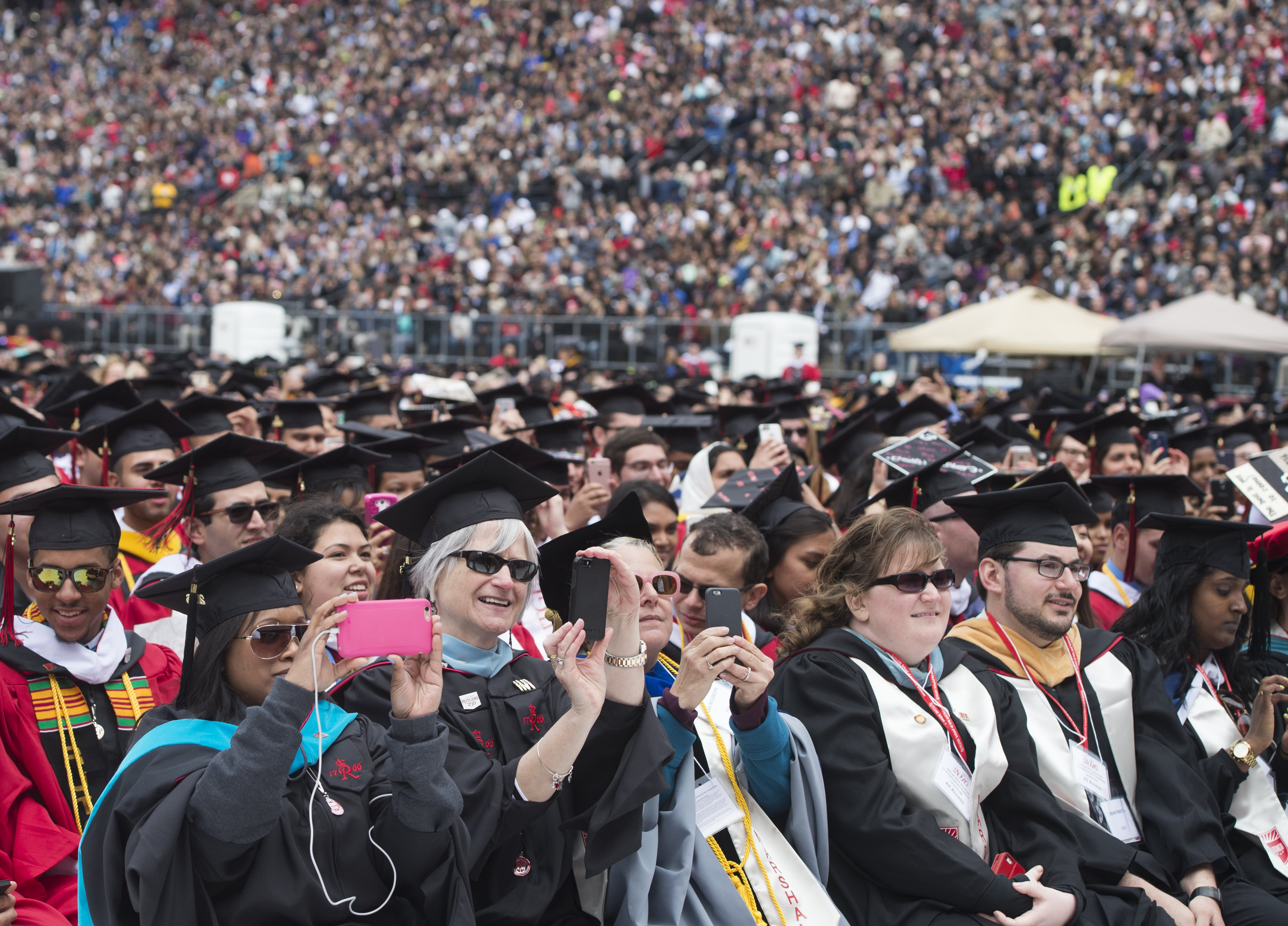 Graduates and attendees listen as US President Barack Obama delivers the commencement address for Rutgers University at High Point Solutions Stadium in Piscataway, New Jersey.  (Saul Loeb/AFP/Getty)