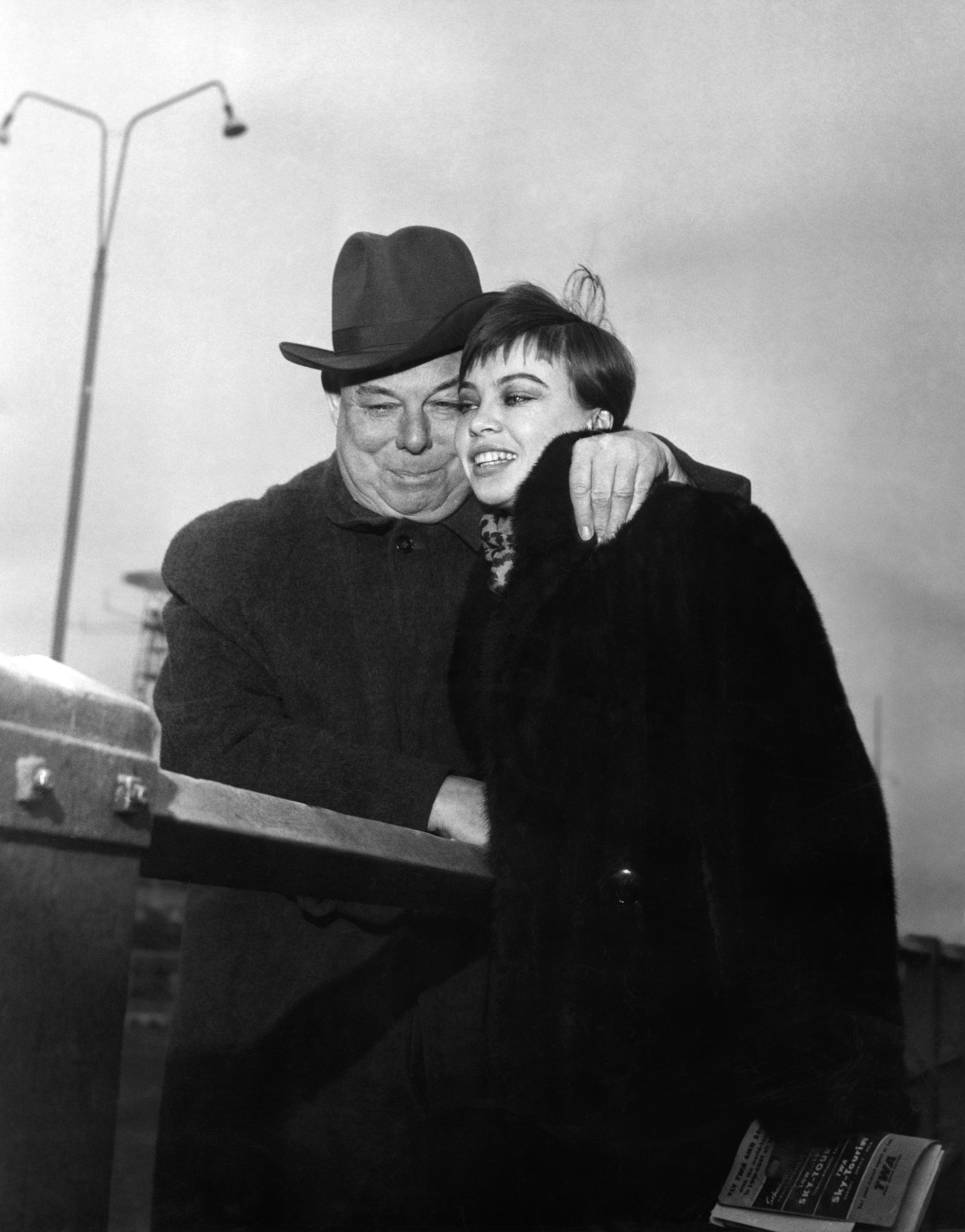 Undated picture shows French film director Jean Renoir with French actress Leslie Caron. (Getty)