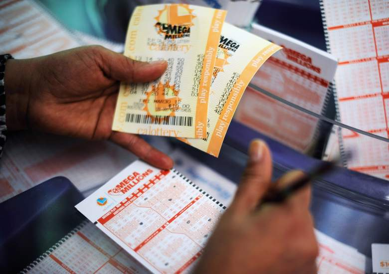 COVINA, CA - MARCH 30:  A woman fills out a Mega Millions lottery ticket form at Liquorland on March 30, 2012 in Covina, California The Mega Millions jackpot has reached a high of $640 million  before the drawing tonight.   (Photo by Kevork Djansezian/Getty Images)