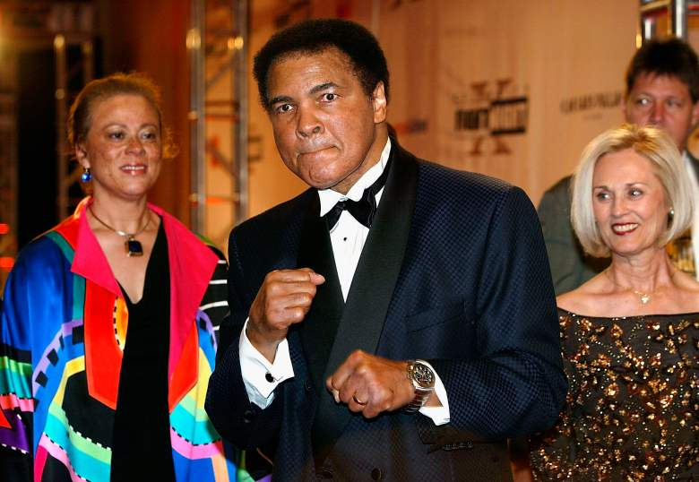 PHOENIX, AZ - MARCH 27: Former heavyweight champion of the world Muhammad Ali (C) and wife Lonnie Ali (L) arrives at 'Celebrity Fight Night X', a charity event to raise money for the Muhammad Ali Parkinson Research Center at Barrow Neurological Institute March 27, 2004, in Pheonix, Arizona. The 'Muhammad Ali Awards' are a way to acknowledge leaders in sports, entertainment and business communities who best represent the qualities associated with Ali's fight to find a cure. (Photo by Carlo Allegri/Getty Images)