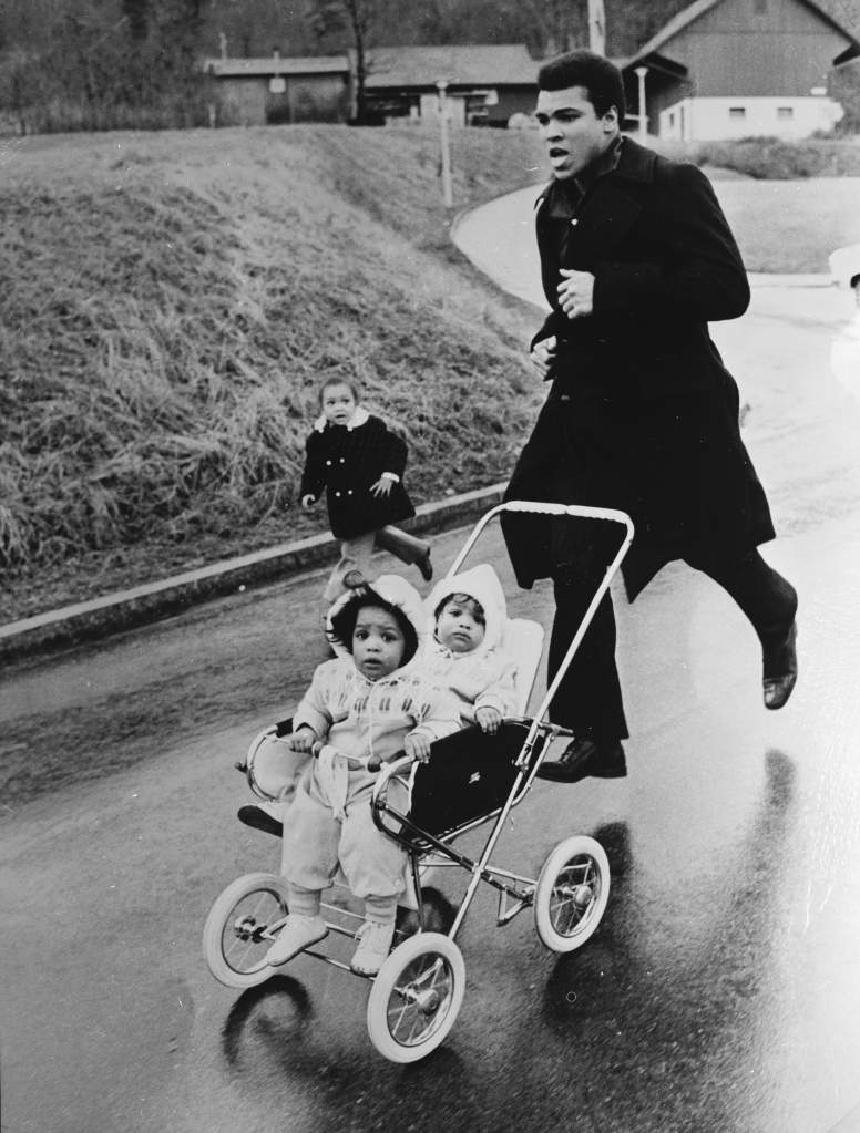 22nd December 1971: Muhammad Ali trains in Zurich for his fight against the West German Jurgen Blin, with his twin daughters Jamillah and Rasheda. (Photo by Central Press/Getty Images)