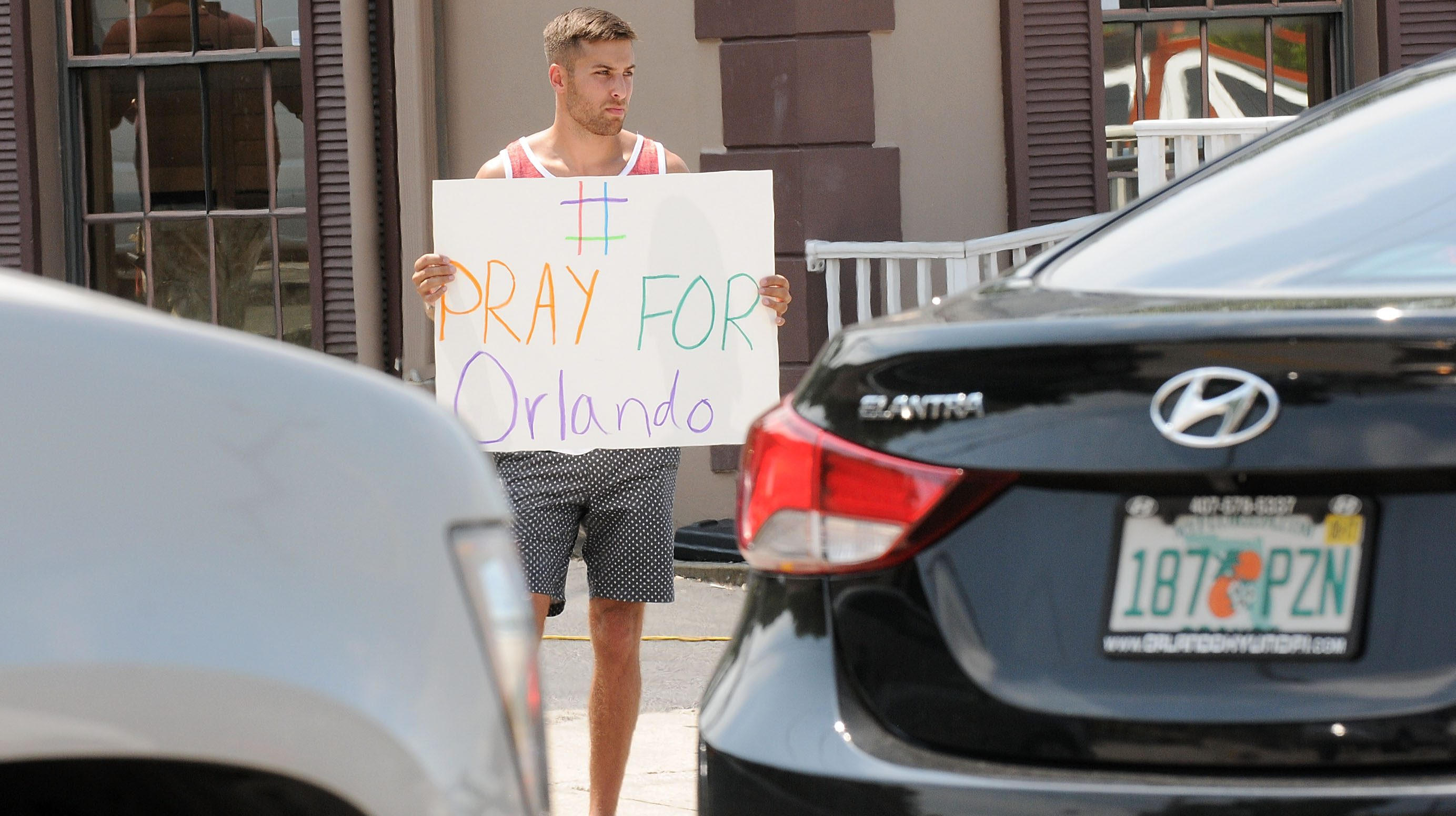 A man holds a sign in support of the victims of the terror attack at gay nightclub Pulse on June 12, 2016 in Orlando, Florida. (Photo by Gerardo Mora/Getty Images)