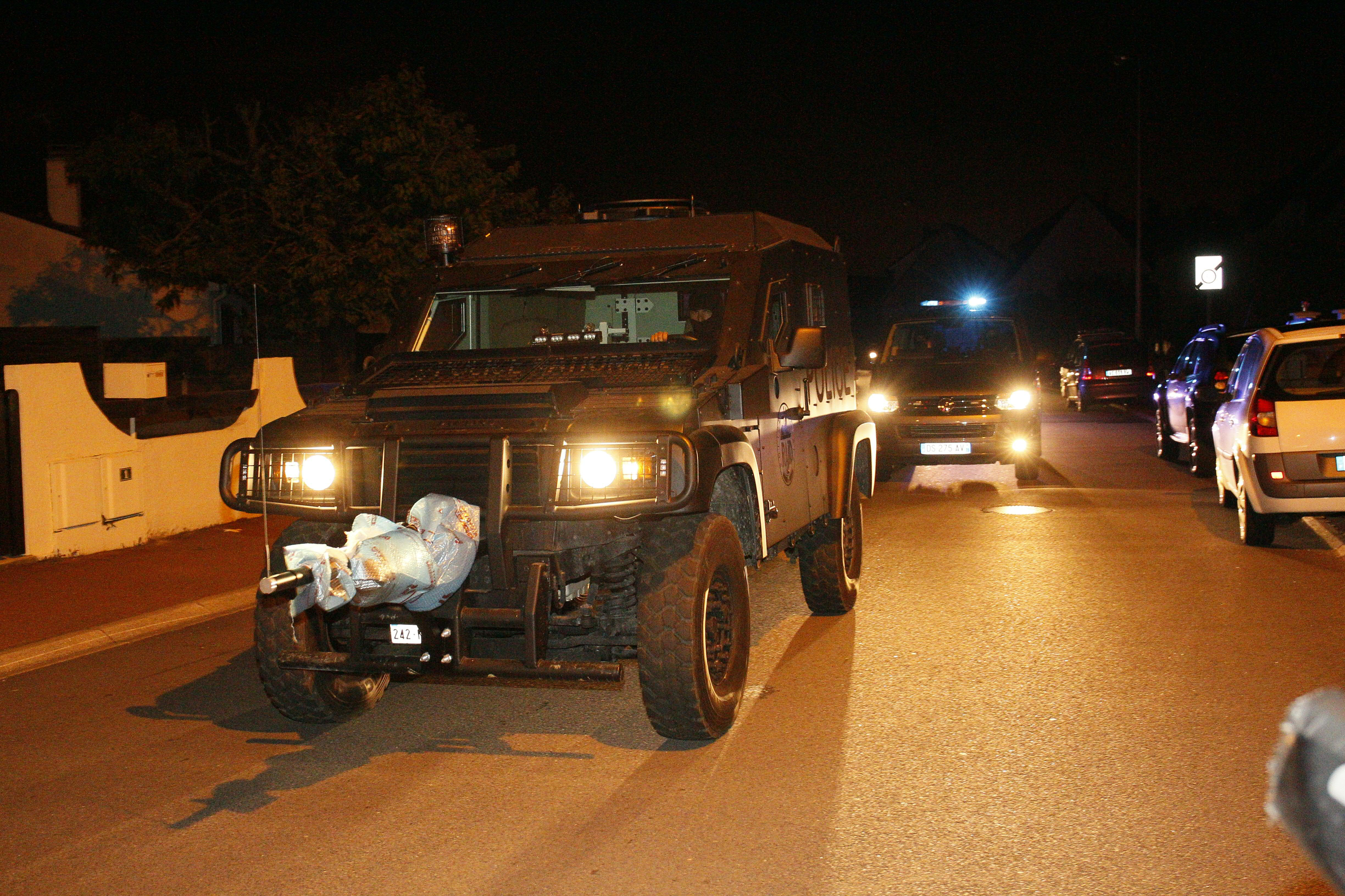 French special forces RAID vehicle leaves after an assault on June 14, 2016 in Magnanville, 45 kms west of Paris. (Getty)
