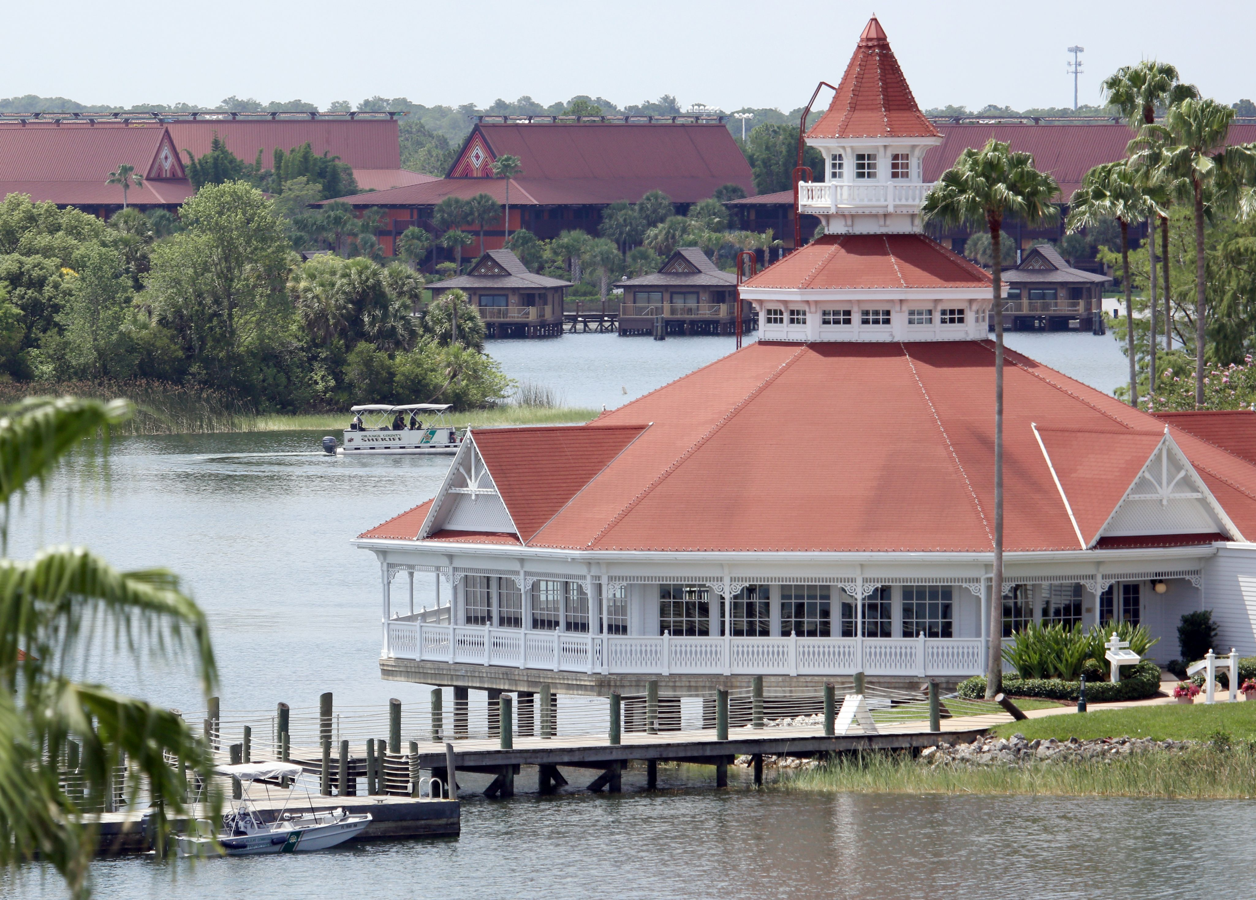A boat belonging to the Florida Fish and Wildlife Conservation Commission is parked at a dock at the Seven Seas Lagoon outside Disney's Grand Floridian Resort & Spa near Orlando, Florida on June 15, 2016. (Getty)
