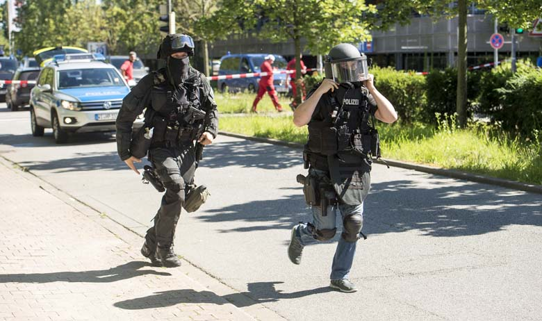 Heavily-armed police outside a movie theatre complex where an armed man has reportedly opened fire on June 23, 2016 in Viernheim, Germany. According to initial media reports, the man entered the cinema today at approximately 3pm, fired a shot in the air and barricaded himself inside. (Getty)
