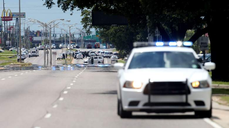 BATON ROUGE, LA - JULY 17: Baton Rouge Police officers patrol Airline Hwy after 3 police officers were killed early this morning on July 17, 2016 in Baton Rouge, Louisiana. According to reports, one suspect has been killed while others are still being sought by police. (Photo by Sean Gardner/Getty Images)