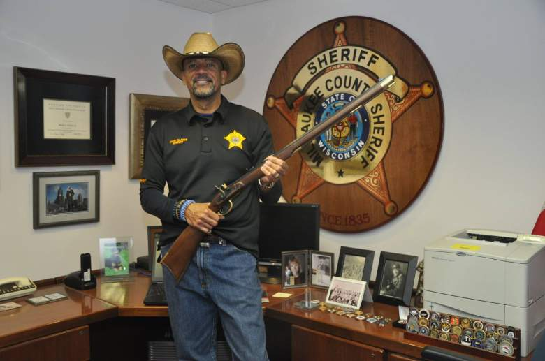 "A 2015 photo from the Milwaukee County Sheriff's Facebook page. It's captioned, ""Sheriff Clarke was presented with a black powder muzzle loading rifle last week for receiving the Charlton Heston Courage Under Fire Award. From an MCSO news release at the time of the award in February."" (Facebook)"