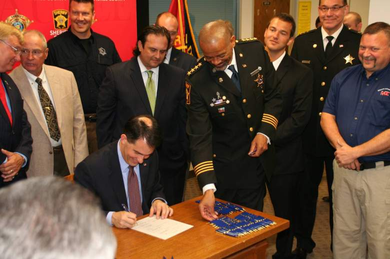 Sheriff Clarke with Wisconsin Gov. Scott Walker at a bill signing ceremony. (Facebook/Milwaukee County Sheriff's Department)