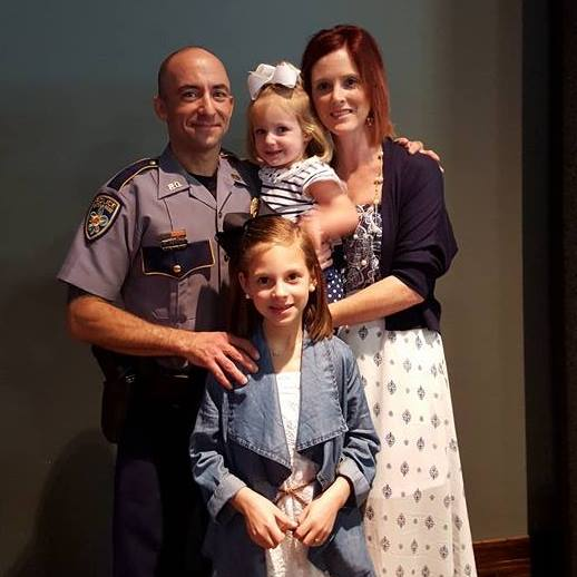 Officer Matthew Gerald with his wife and two children. (Facebook)
