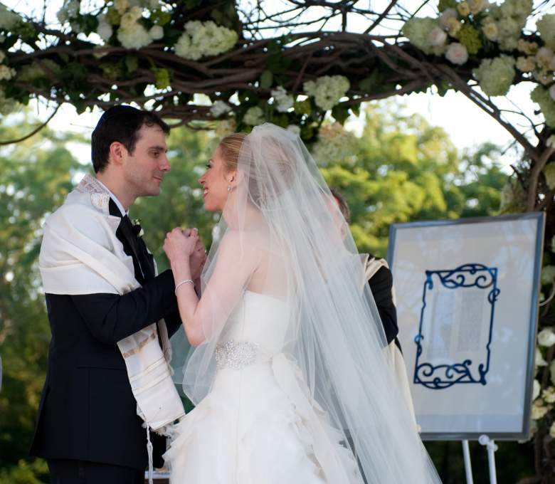 RHINEBECK, NY - JULY 31: In this handout image provided by Genevieve de Manio, Chelsea Clinton (R) weds Marc Mezvinsky at the Astor Courts Estate on July 31, 2010 in Rhinebeck, New York. Chelsea Clinton, the daughter of former U.S. President Bill Clinton and Secretary of State Hillary Clinton, married Marc Mezvinsky today in an interfaith ceremony at the estate built by John Jacob Astor on the Hudson River about two hours north of New York City. (Photo by Genevieve de Manio via Getty Images)