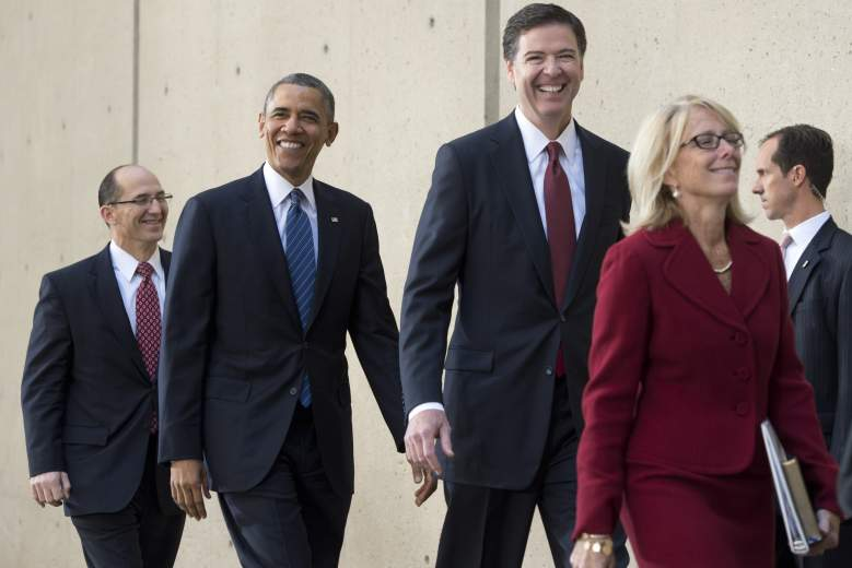 US President Barack Obama arrives alongside new FBI Director James Comey (2nd R), Comey's wife, Patrice Failor (R), and FBI Deputy Director Sean Joyce (L) during an installation ceremony at FBI Headquarters in Washington, DC, October 28, 2013. (Getty)