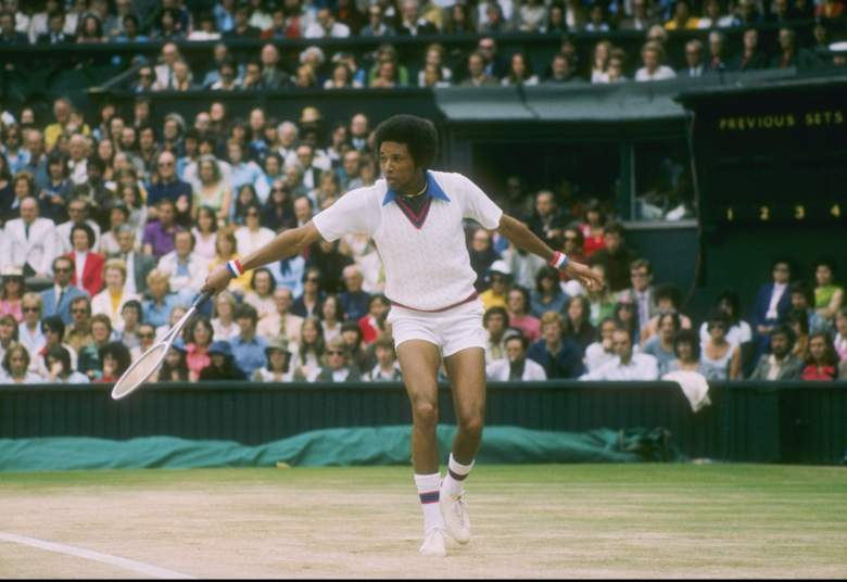 Arthur Ashe runs for the ball during a match at Wimbledon in England. (Getty)