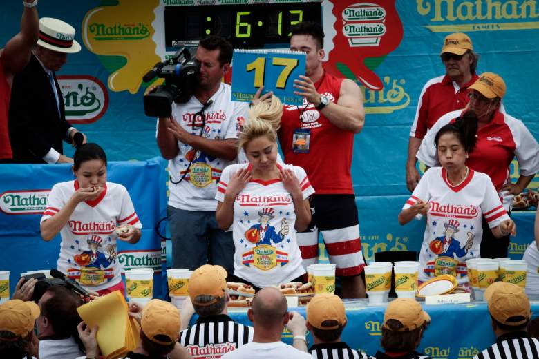 Sonya Thomas, Miki Sudo and Juliet Lee compete in the women's division of the Nathan's Famous Hot Dog Eating Contest at Coney Island. (Getty)