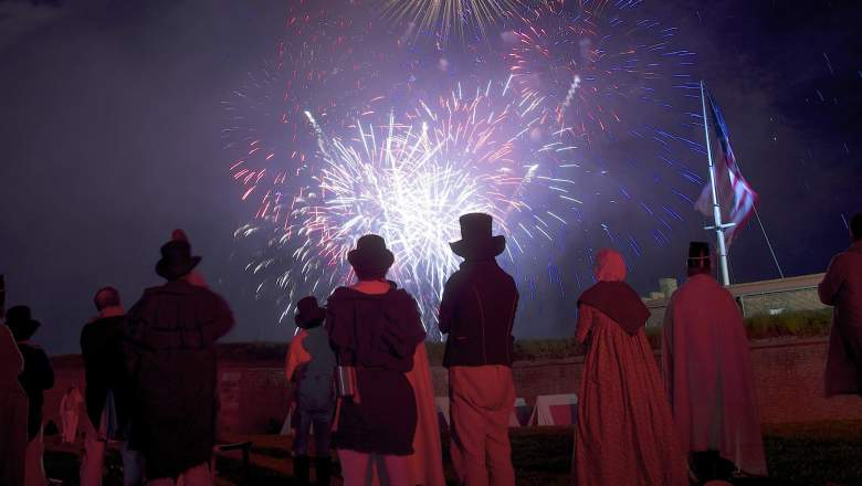 BALTIMORE, MD - SEPTEMBER 13: War of 1812 reenactors watch a fireworks display following a ceremony to commemorate the bicentennial of the writing of The Star-Spangled Banner at Fort McHenry National Historic Park on September 13, 2014 in Baltimore, Maryland.  The poem verses were written by Francis Scott Key in the War of 1812, during a British naval bombardment of Fort McHenry from the Chesapeake Bay, and adopted as The National Anthem 200 years ago.  (Photo by Mark Makela/Getty Images)