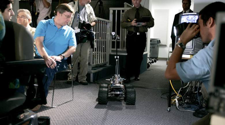 A technician from the United States Army Rapid Equipping Force (REF) steers the Multi-Function Agile Remote-Controlled Robot (MARCBOT), a small robot on four wheels that has a video camera lens for eyes, into a press conference in 2005. It's not yet clear what robot was used by the Dallas police, but it's been indicated that it too is likely to be a MARCbot. (Getty)