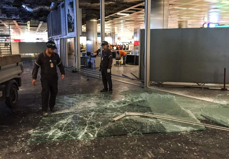 Authorized personnel clear glass debris in Ataturk airport's International arrival terminal, a day after a suicide bombing and gun attack targeted Istanbul's airport. (Getty)