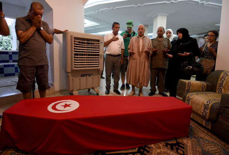Relatives of Tunisian doctor Fathi Bayoudh, who was killed in the Istanbul airport attack blamed on the Islamic State (IS) group on June 28, pray over his coffin.(Getty)