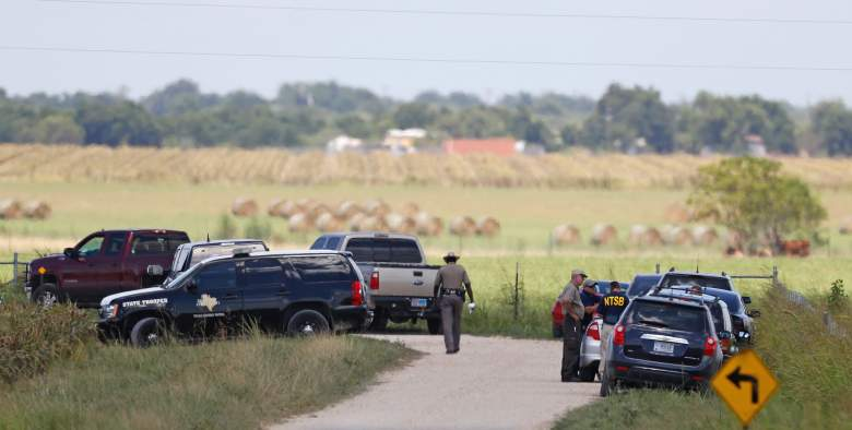"Authorities investigate the site of a hot air balloon accident in Maxwell, Texas on July 30, 2016. Up to 16 people are feared dead after a large hot air balloon caught fire and crashed in central Texas on Saturday, officials said. The accident took place shortly after 7:40 am (1240 GMT), when the balloon crashed into a field near Lockhart, around 30 miles (50 kilometres) south of Austin, Lynn Lunsford of the Federal Aviation Administration (FAA) said in a statement. ""It does not appear at this time that there were any survivors of the crash,"" the Caldwell County sheriff's office said. / AFP / AARON M. SPRECHER (Photo credit should read AARON M. SPRECHER/AFP/Getty Images)"
