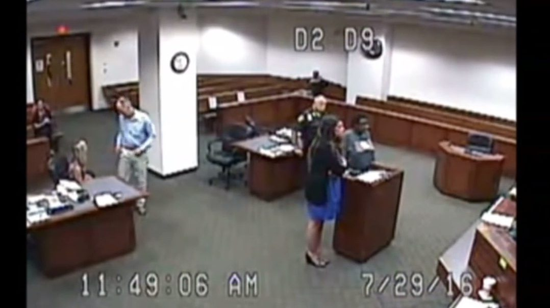 A screengrab shows the woman and her attorney.