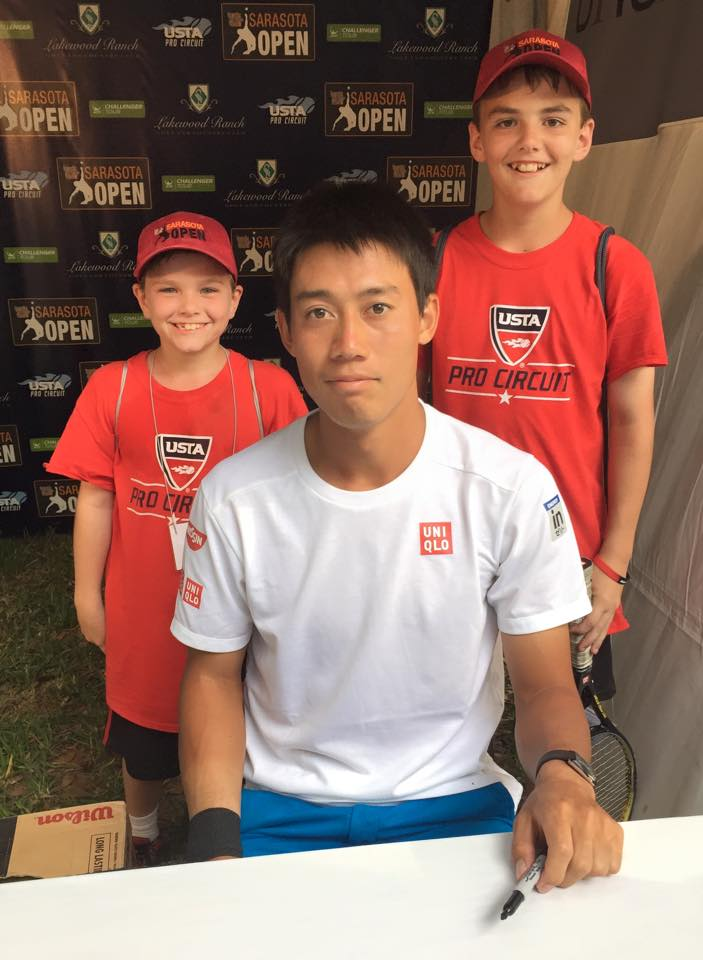 """Stephen Brumby's mother wrote on this photo, """"Stephen and Thomas at the Sarasota Open with Kei Nishikori, the #4 player in the world!"""" (Facebook/Elizabeth Brumby)"""