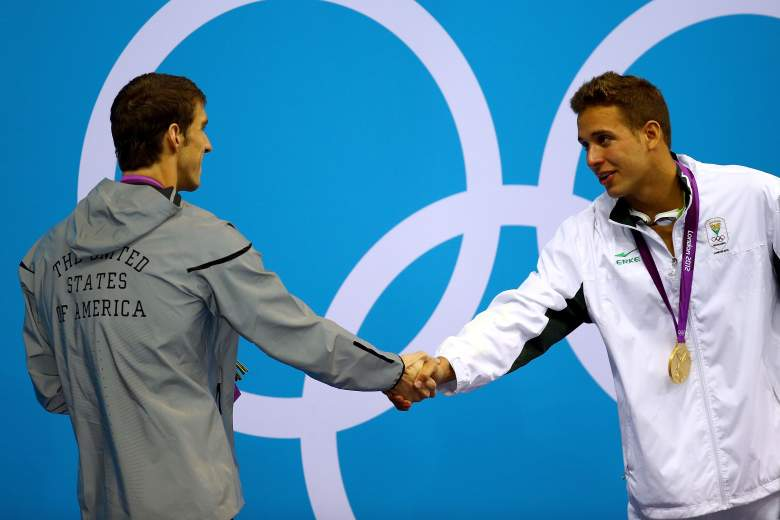 Silver medallist Michael Phelps of the United States shakes hands with gold medallist Chad le Clos of South Africa after receiving their medals during the medal ceremony for the Men's 200m Butterfly final on Day 4 of the London 2012 Olympic Games. (Getty)