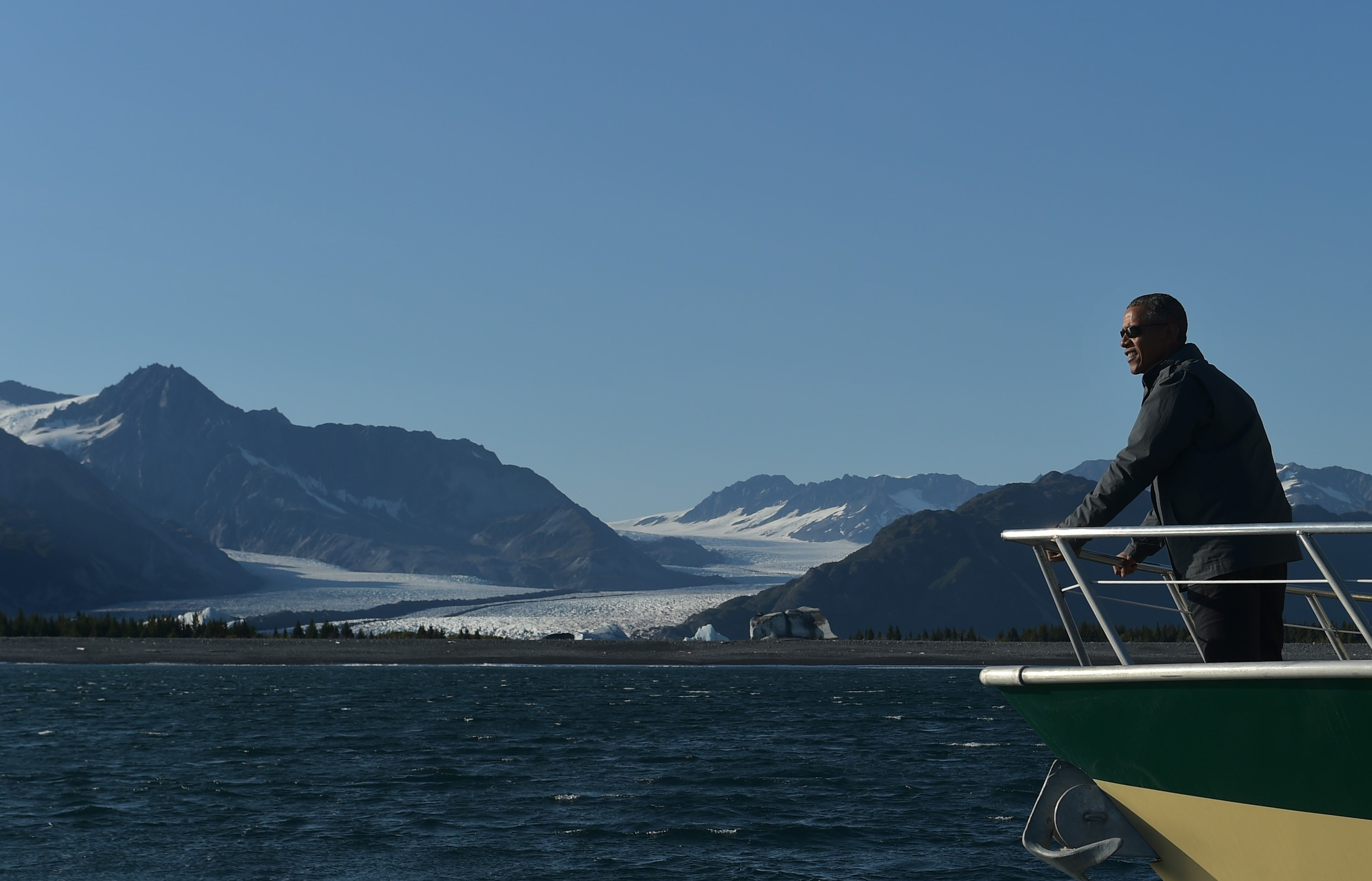 US President Barack Obama looks at Bear Glacier during a boat tour of the Kenai Fjords National Park on September 1, 2015 in Seward, Alaska. (Getty)