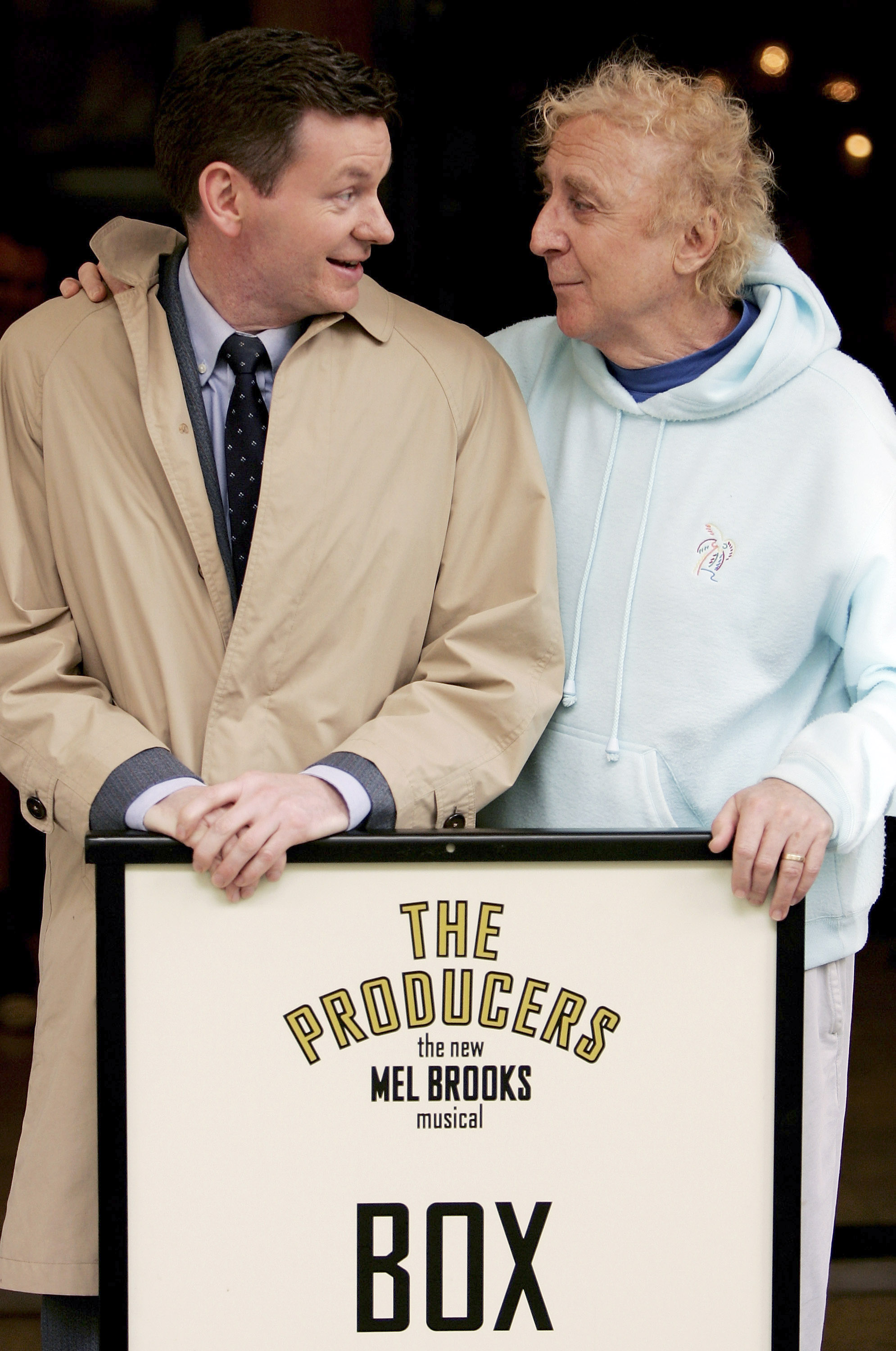 Actors Gene Wilder and John Gordon Sinclair pose on the steps of The Producers' theatrical home, the Theatre Royal, Drury Lane, on June 6, 2005 in London, England. The stars played the role of the current and former Leo Bloom, with Wilder starring in the 1968 film version and Sinclair presently on the West End stage acting the same role. (Getty)