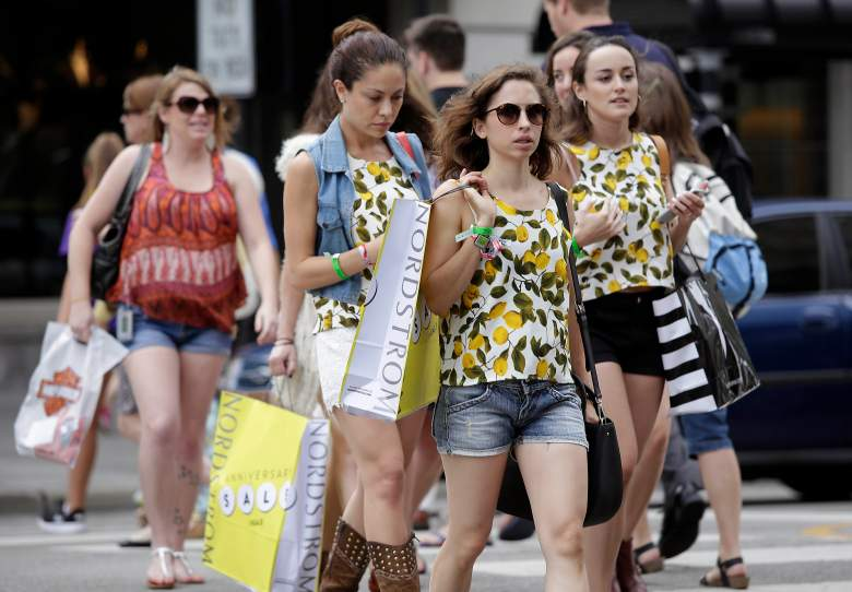 CHICAGO, IL - JULY 29: Consumers hold shopping bags as they walk along Michigan Avenue on July 29, 2016 in Chicago, Illinois. The US economy grew by 1.2% in the second quarter weaker than economists expected. (Photo by Joshua Lott/Getty Images)